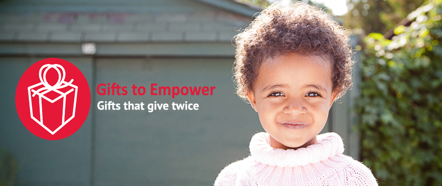 "A cute smiling young girl with the text ""Gifts to Empower, gifts that give twice"