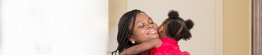 grateful mom holding baby