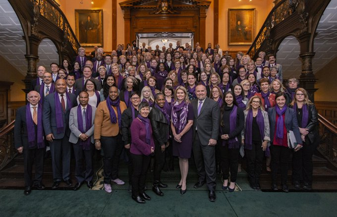 MPs at Queen's park wearing purple scarves