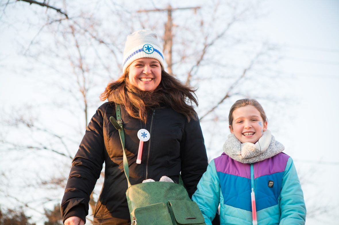 A mom and daughter on a winter walk.