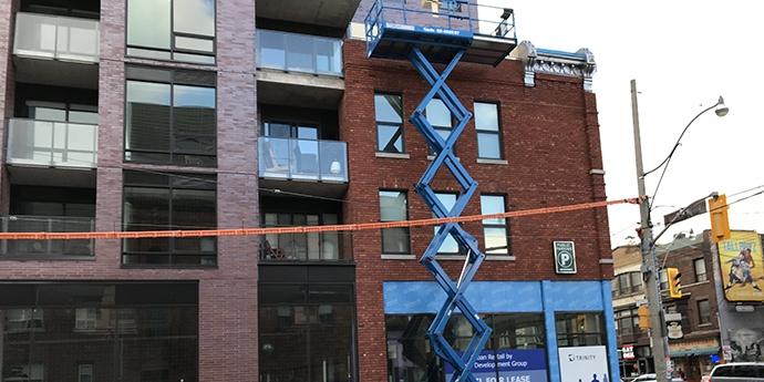 Brick Building with Crane
