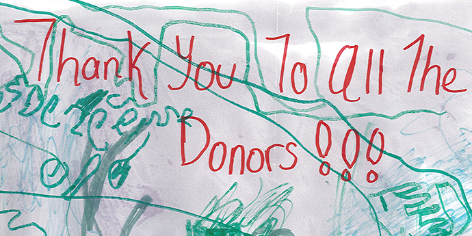 """a child's abstract drawing with the words """"Thank you to all the donors!!!"""""""