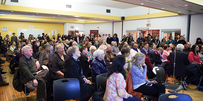 a crowd of people at  town hall meeting