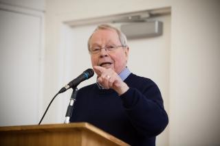 David Crombie speaking at podium
