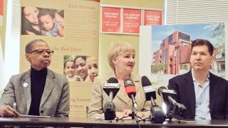 Bernnitta Hawkins, Councillor Fletcher, Chris Harhay seated at press conference