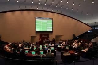 Council chamber with board showing yes votes